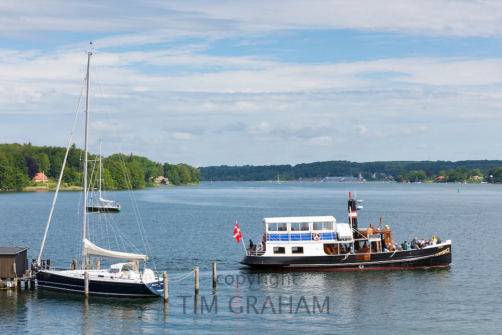 Ferry boat in harbour scene at Tasinge Island off Svendborg, of South Funen Archipelago, Denmark