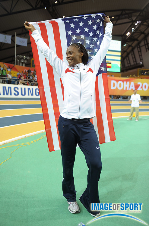 Mar 13, 2010; Doha, QATAR; Chaunte Lowe (USA) takes a victory lap after finishing third in the women's high jump in the IAAF World Championships in Athletics at the Aspire Dome.