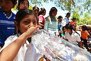 Guarani girl drinking clean water in Gutierrez, Santa Cruz, Bolivia