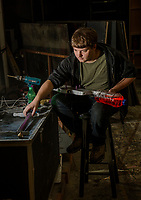 "Zach Glennon builds a ""ray gun"" for a prop in the upcoming production of ""Rocky Horror Show"" at the Winnipesaukee Playhouse opening June 14th.  (Karen Bobotas/for the Laconia Daily Sun)"