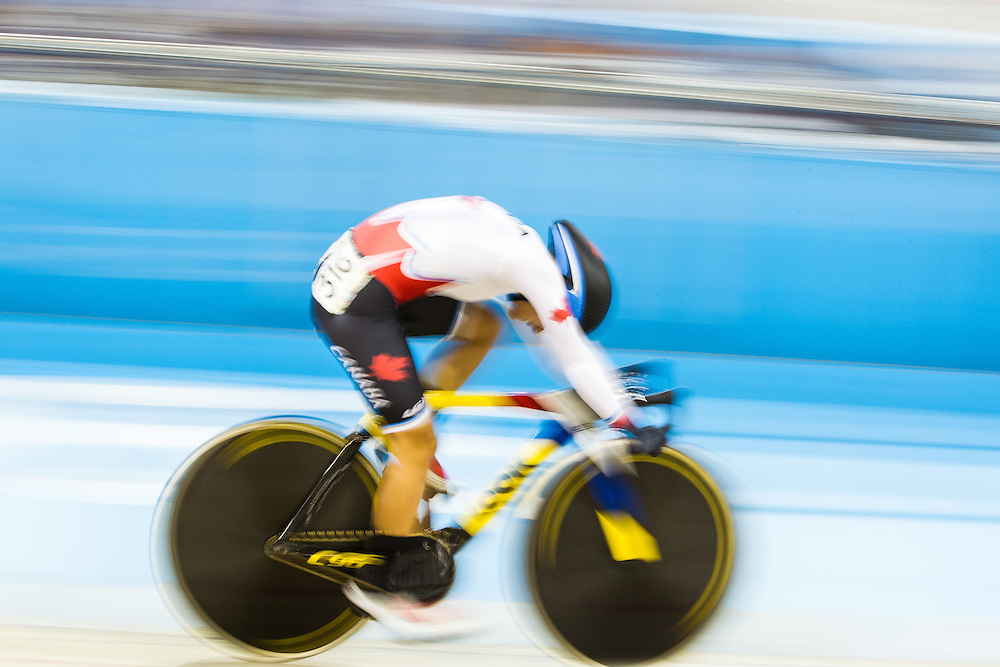 Jasmin Glaesser competes in the women's cycling omnium flying lap at the 2015 Pan American Games in Toronto, Canada, July 19,  2015.  AFP PHOTO/GEOFF ROBINS