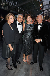 Mayor of London SADIQ KHAN, his wife SAADIYA, ALEXANDRA SHULMAN and GIORGIO ARMANI at British Vogue's Centenary Gala Dinner in Kensington Gardens, London on 23rd May 2016.
