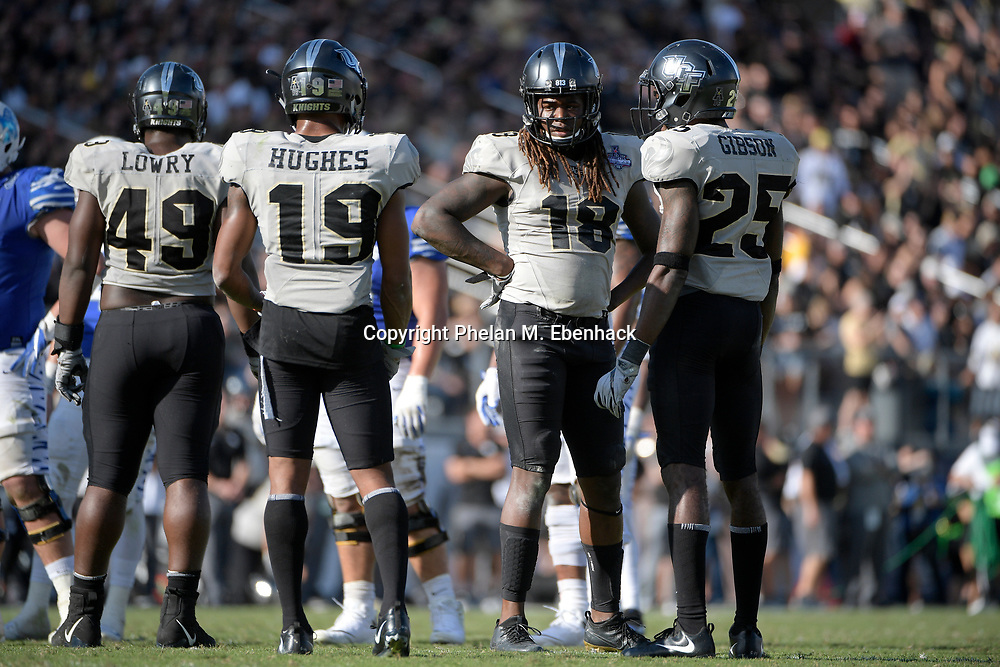 Central Florida linebacker Shaquem Griffin (18) waits for a play during the second half of the American Athletic Conference championship NCAA college football game against Memphis Saturday, Dec. 2, 2017, in Orlando, Fla. Central Florida won 62-55. (Photo by Phelan M. Ebenhack)