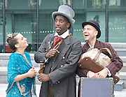 Around the World in 80 Days <br /> at The Scoop, More London, Great Britain <br /> press photocall<br /> 5th August 2011 <br /> <br /> Suzanne Ahmet (as Princess Aouda)<br /> Eugene Washington (as Phileas Fogg)<br /> Joseph Wicks (as Passepartout)<br /> <br /> <br /> <br /> Photograph by Elliott Franks
