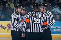 KELOWNA, CANADA - APRIL 18: Referees Sean Raphael and Reagan Vetter gather at centre ice with linesmen Mike Langin and Nathan Van Oosten as the # of the Kelowna Rockets host the Portland Winterhawks on April 18, 2014 during Game 1 of the third round of WHL Playoffs at Prospera Place in Kelowna, British Columbia, Canada.   (Photo by Marissa Baecker/Shoot the Breeze)  *** Local Caption *** Referees; Sean Raphael; Reagan Vetter; Mike Langin; Nathan Van Oosten; linesmen; linesman; officials;