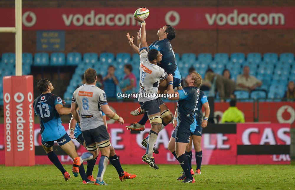 Steve Mafi of the Force and Jan Serfontein of the Bulls jumping for the high ball during the Super Rugby match between the Vodacom Bulls and the Force at the Loftus Versfeld on  21 March 2015<br /> &copy;BackpagePix