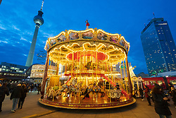 Traditional Christmas Market at Alexanderplatz in Mitte, Berlin, Germany. Pictured double height carousel