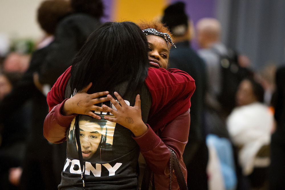 Precious Coleman, right, embraces Enfinity Latham during the funeral for Tony Robinson, Jr. at Madison East High School in Madison, Wisconsin, Saturday, March 14, 2015. Hundreds of people gathered on Saturday for the funeral of a 19-year-old man killed by a police officer in Wisconsin's capital on March 6, a shooting that prompted protests over law enforcement's treatment of minorities.  REUTERS/Ben Brewer (UNITED STATES)