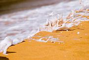 Surf detail at Secret Beach on the North Shore, Island of Kauai, Hawaii