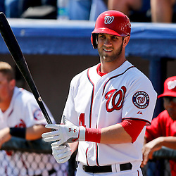 Mar 8, 2013; Melbourne, FL, USA; Washington Nationals center fielder Bryce Harper (34) waits on deck to bat against the St. Louis Cardinals during the bottom of the first inning of a spring training game at Space Coast Stadium. Mandatory Credit: Derick E. Hingle-USA TODAY Sports