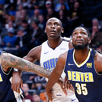 11 November 2017: Orlando Magic center Bismack Biyombo (11) vies for the rebound with Denver Nuggets forward Kenneth Faried (35) and Denver Nuggets forward Wilson Chandler (21) during the Denver Nuggets 125-107 victory over the Orlando Magic, at the Pepsi Center, Denver, Colorado, USA.
