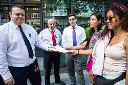 London, UK. 29 July, 2019. Two activists present a letter on behalf of Reclaim the Power, All African Women's Group, Docs Not Cops, Lesbians and Gays Support the Migrants and other groups during a protest outside the Home Office to demand an end to the Government's 'hostile environment' policies.