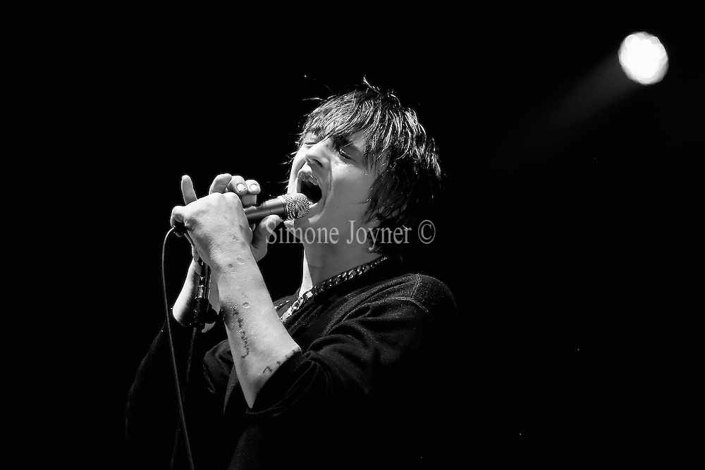 Pete Doherty of Babyshambles performs live on stage at O2 Academy Brixton on September 14, 2013 in London, England.  (Photo by Simone Joyner)