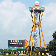 "South of the Border is an internationally-know roadside attraction on Interstate 95 near Dillon, South Carolina, so named because it is just ""south of the border"" between the U.S. states of South and North Carolina. Intentionally campy and over-the-top, the rest area features restaurants, gas stations, motels, a small amusement park, shopping and fireworks. Its mascot is Pedro, an extremely unpolitically-correct Mexican bandido. It is advertised by hundreds of billboards along surrounding highways that start 175 miles away. Photo by LOGAN MOCK-BUNTING"