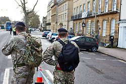 "© Licensed to London News Pictures.  13/02/2014. OXFORD, UK. Army officers at the scene after a suspect package was received at the Army recruitment office in St Giles, Oxford. The package was one of seven received across the country in the last two days and has been described as ""crude but potentially viable with hallmarks of Northern Ireland-related terrorism. Photo credit: Cliff Hide/LNP"