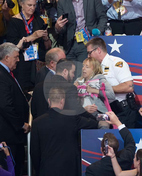 Police remove a Code Pink protester who interrupted the acceptance speech of GOP Presidential candidate Donald Trump on the final day of the Republican National Convention July 21, 2016 in Cleveland, Ohio.