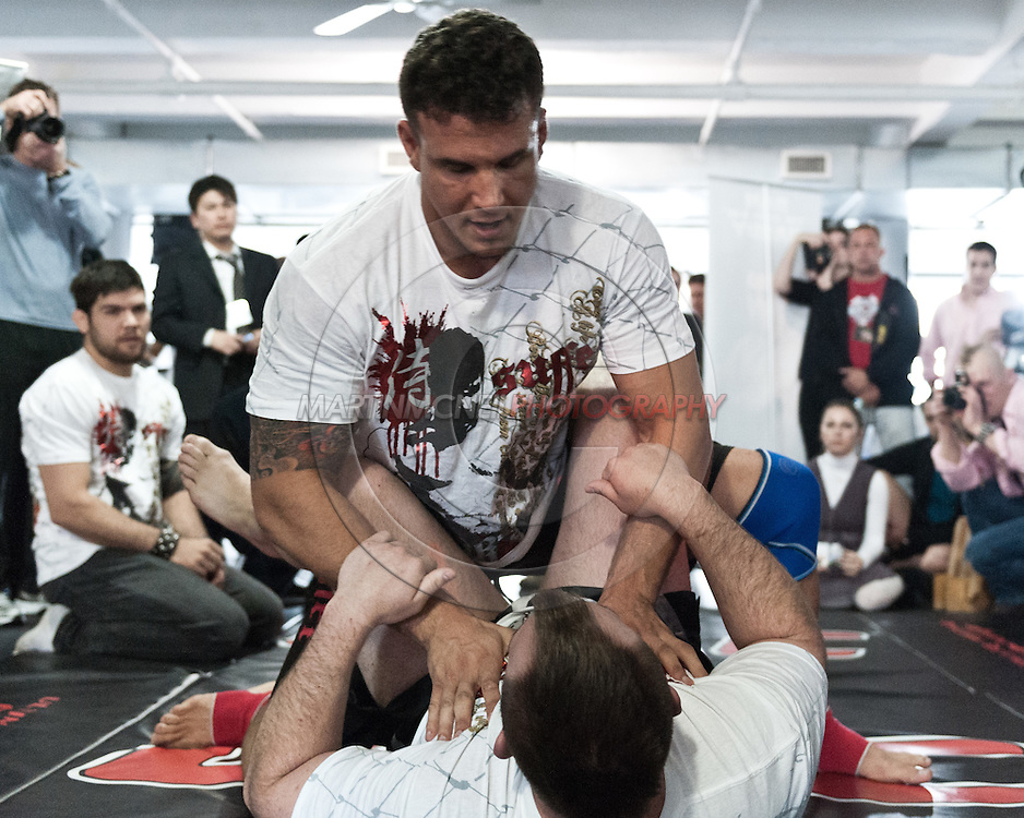 """NEW YORK, NEW YORK, MARCH 25, 2010: Frank Mir (top) works on his grappling during the media open work-out sessions for """"UFC 111: St. Pierre vs. Hardy"""" at Peak Performance Strength and Conditioning Center in Manhattan on March 25, 2010."""