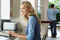 Woman using laptop looking worried