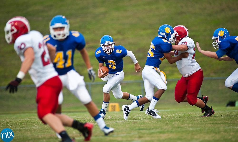Mount Pleasant quarterback Alan McDonald scrambles against South Stanly Friday night at Mount Pleasant High School. South Stanly edged out the Tigers 23-20. (photo by James NIx)