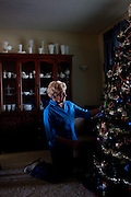 Dee Alvard, 70, points out a favorite ornament on her Christmas tree in her living room in Sun City, Arizona, December 8, 2010. Both Dee and her sister Shirley Compau, who was visiting, are both retired school bus drivers and both lived in RVs before they settled in Sun City. They live with their husbands less than two miles from each other.
