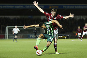 Lyle Taylor of AFC Wimbledon and Luke Prosser of Northampton Town FC battle it out during the Sky Bet League 2 match between Northampton Town and AFC Wimbledon at Sixfields Stadium, Northampton, England on 1 March 2016. Photo by Stuart Butcher.