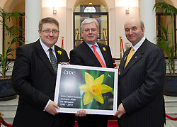 Repro Free: 21/03/2013 An Tánaiste Eamon Gilmore, with, Liam Halpin, General Manager, Dell Ireland (left) and John McCormack, CEO, Irish Cancer Society, puts his stamp of approval on the Irish Cancer Society's Daffodil Day, taking place nationwide tomorrow (Friday 22st March), pictured with a new postage stamp marking the 50th anniversary of the Irish Cancer Society, issued by An Post today.  .The Irish Cancer Society and Dell, lead partners for Daffodil Day, are calling on the Irish public to wear a daffodil today and support those affected by cancer in Ireland. Picture Andres Poveda.