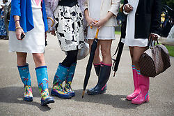 © licensed to London News Pictures.16/06/2011. Ascot, UK. Rain soaked Ladies day at Royal Ascot races today (16/06/2011). The 5 day showcase event is one of the highlights of the racing calendar. Horse racing has been held at the famous Berkshire course since 1711 and tradition is a hallmark of the meeting. Top hats and tails remain compulsory in parts of the course. Photo credit should read: Ben Cawthra/LNP