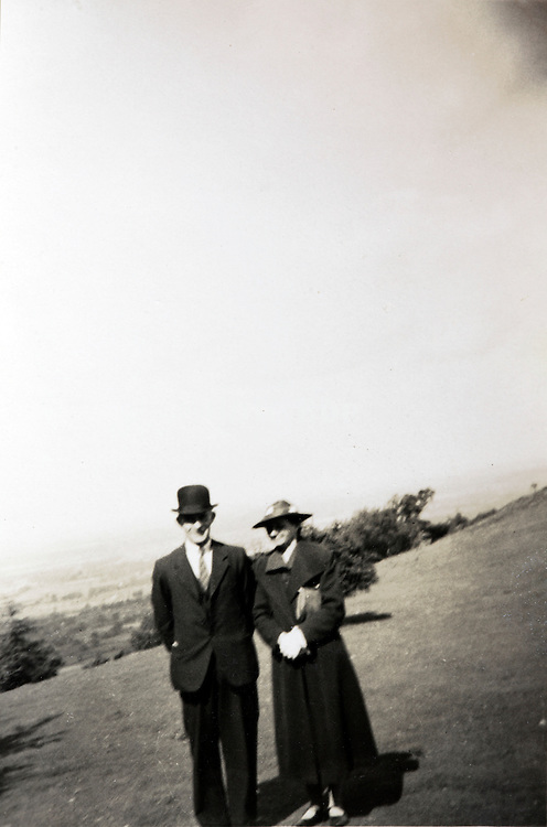 portrait of elderly couple posing in an open field England 1900s