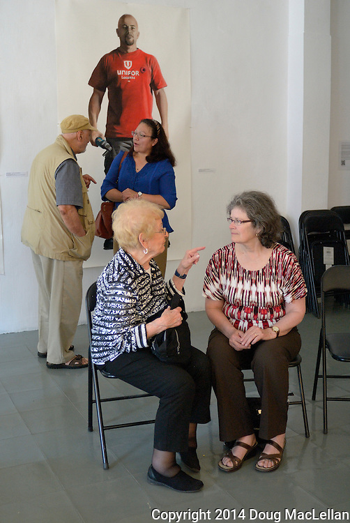 The conversations turn informal after a two hour question and answer period at the annual Cuban Canadian Freindship Association Windsor meeting at Artcite Inc. The event is part of the MayWorks labour arts festival.