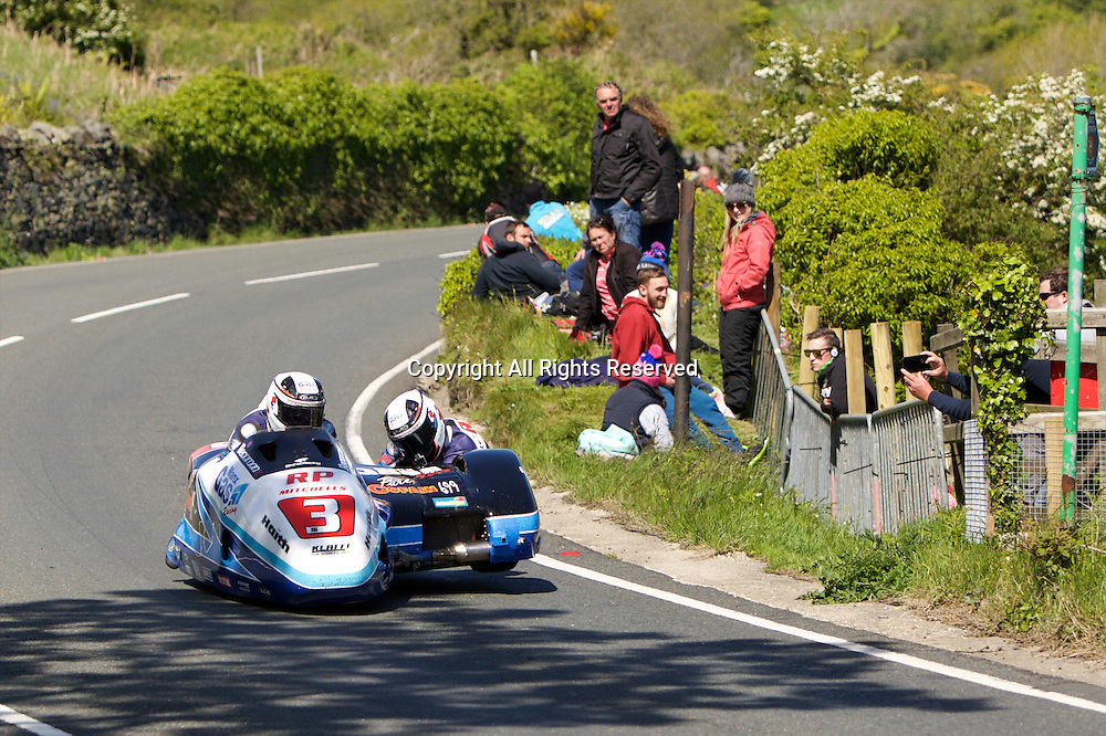 08.06.2015. Douglas, Isle of Man. 2015 Isle of Man TT Races. Ben Birchall and Tom Birchall in action during the TT Sidecar race.