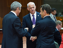 George Papandreou, Greece's prime minister, center, speaks with Nicolas Sarkozy, France's president, right, and Jose Socrates, Portugal's prime minister, during the European Summit meeting at EU Council headquarters in Brussels, Belgium, on Thursday, June 17, 2010. (Photo © Jock Fistick)