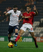 Alan Browne and Jorge Grant battle during the Sky Bet Championship match between Preston North End and Nottingham Forest at Deepdale, Preston, England on 3 November 2015. Photo by Pete Burns.