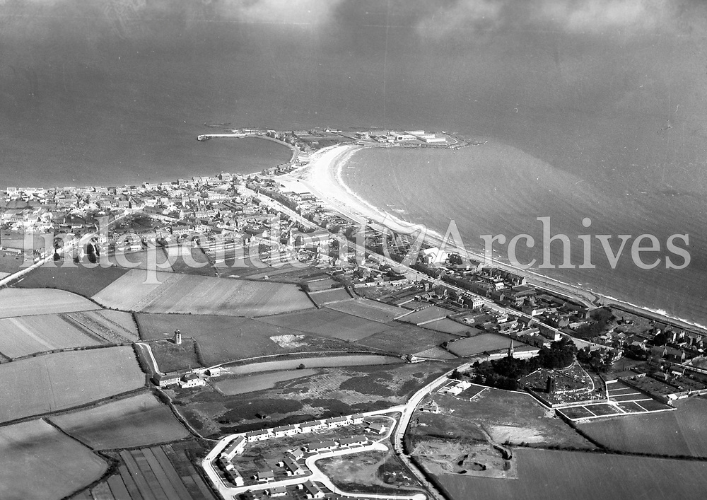 A401 Skerries.   No date. (Part of the Independent Newspapers Ireland/NLI collection.)<br /> <br /> <br /> These aerial views of Ireland from the Morgan Collection were taken during the mid-1950's, comprising medium and low altitude black-and-white birds-eye views of places and events, many of which were commissioned by clients. From 1951 to 1958 a different aerial picture was published each Friday in the Irish Independent in a series called, 'Views from the Air'.The photographer was Alexander 'Monkey' Campbell Morgan (1919-1958). Born in London and part of the Royal Artillery Air Corps, on leaving the army he started Aerophotos in Ireland. He was killed when, on business, his plane crashed flying from Shannon.
