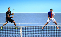 Marcelo Melo and Lukasz Kubot (right) in action during their doubles match during day four of the NITTO ATP World Tour Finals at the O2 Arena, London.