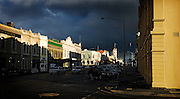 storm clouds and sun on Lydiard St Nth buildings