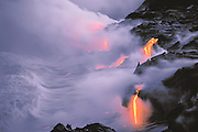 Lava flow entering the sea at twilight, Hawaii Volcanoes National Park, Hawaii