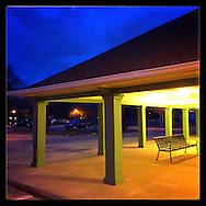 Garden City, NY: April 2015--- The Garden City Long Island Railroad station takes on an Edward Hopper-like look at dusk. © Audrey C. Tiernan