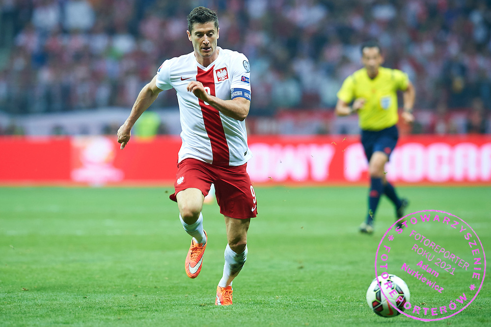 Poland's Robert Lewandowski controls the ball during the EURO 2016 qualifying match between Poland and Germany on October 11, 2014 at the National stadium in Warsaw, Poland<br /> <br /> Picture also available in RAW (NEF) or TIFF format on special request.<br /> <br /> For editorial use only. Any commercial or promotional use requires permission.<br /> <br /> Mandatory credit:<br /> Photo by &copy; Adam Nurkiewicz / Mediasport