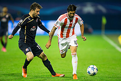 Goncalo Santos #13 of GNK Dinamo Zagreb and Alejandro Damaian Dominguez #10 of Olympiakos during football match between GNK Dinamo Zagreb and Olympiakos in Group F of Group Stage of UEFA Champions League 2015/16, on October 20, 2015 in Stadium Maksimir, Zagreb, Croatia. Photo by Urban Urbanc / Sportida
