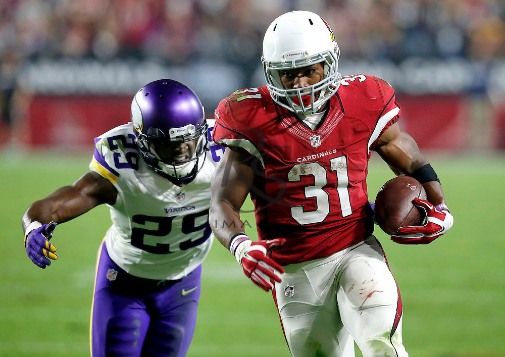 Arizona Cardinals running back David Johnson (31) runs as Minnesota Vikings cornerback Xavier Rhodes (29) pursues during the second half of an NFL football game, Thursday, Dec. 10, 2015, in Glendale, Ariz. (AP Photo/Rick Scuteri)