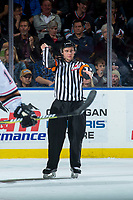 KELOWNA, CANADA - OCTOBER 13: Referee Mark Pearce makes a slashing call at the Kelowna Rockets against the Calgary Hitmen on October 13, 2017 at Prospera Place in Kelowna, British Columbia, Canada.  (Photo by Marissa Baecker/Shoot the Breeze)  *** Local Caption ***