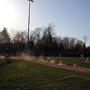 Dust catches the sunlight as a batter runs to first base during the High School Baseball ball game between Trumbull Golden Eagles and McMahon Senators at Brien McMahon High School. Norwalk, Connecticut. USA. 26th April 2012. Photo Tim Clayton