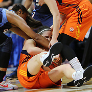 UNCASVILLE, CONNECTICUT- JUNE 3:  Kelly Faris #34 of the Connecticut Sun fighting for a steal with Angel McCoughtry #35 of the Atlanta Dream during the Atlanta Dream Vs Connecticut Sun, WNBA regular season game at Mohegan Sun Arena on June 3, 2016 in Uncasville, Connecticut. (Photo by Tim Clayton/Corbis via Getty Images)