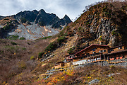 "Karasawa Goya hut, 2360m/7740ft elevation. Karasawa cirque is cradled by the Hotaka Mountains, in the ""Northern Japan Alps"" (Hida Mountains) in Chubu-Sangaku National Park, Japan. Within the cirque, two lodges provide beds and meals for hikers and climbers: Karasawa Goya and Karasawa Hutte. Also known as Mount Hotaka or Hotaka-dake, the Hotaka Mountains reach 3190 meters elevation atop Mount Oku-Hotaka, Japan's third highest peak. About 2000 meters in diameter, the cirque bottoms out at 2300 m elevation. Snow melting here forms the River Azusa which flows through Kamikochi valley below."