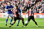 Ipswich Town forward David McGoldrick (10) takes shot at goal Sheffield United defender Cameron Carter-Vickers (16) hits Sheffield United defender Kieron Freeman (18) in leg during the EFL Sky Bet Championship match between Sheffield Utd and Ipswich Town at Bramall Lane, Sheffield, England on 14 October 2017. Photo by Ian Lyall.