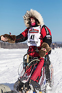 Musher Aliy Zirkle competing in the 45rd Iditarod Trail Sled Dog Race on the Chena River after leaving the restart in Fairbanks in Interior Alaska.  Afternoon. Winter.
