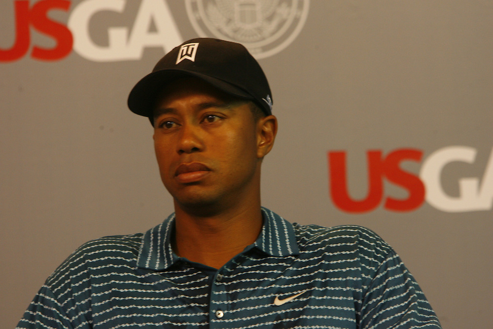 Tiger Woods of the US smiles as he answers questions at a press conference during a practice day at the US Open Golf Championship at Winged Foot Golf Club in Mamaroneck New York Tuesday 13 June 2006. The US Open is the first tournament Wodds has played since his father Earl Woods died.