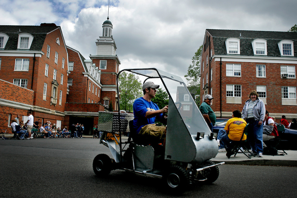 Ryan Elliot, 23, a mechanical engineering student takes one of the electric cars for a test drive in front of Stocker Center on Saturday, May 6th.