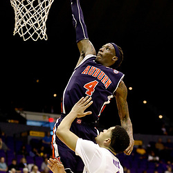 Feb 21, 2017; Baton Rouge, LA, USA; Auburn Tigers guard T.J. Dunans (4) dunks \LSU Tigers guard Skylar Mays (4) during the second half of a game at Pete Maravich Assembly Center. Auburn defeated LSU 98-75. Mandatory Credit: Derick E. Hingle-USA TODAY Sports