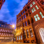 View of the old Cosby Hotel at end of the street recently saved from demolition, 9th and Baltimore Streets, downtown Kansas City, Missouri.